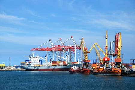 loading cargo: Port warehouse with containers and industrial cargoes Stock Photo