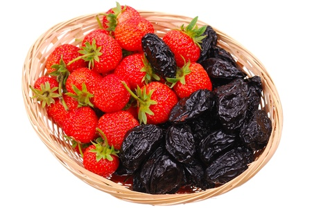 Basket with fresh strawberry and prune isolated photo