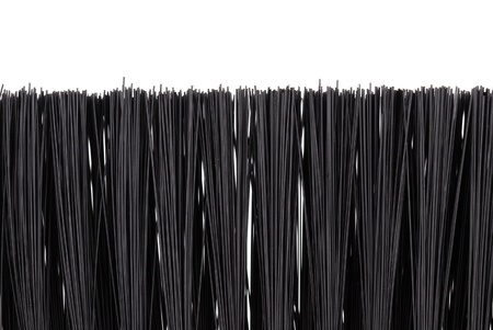 scour: black bristle brush isolated on a white
