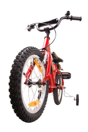 New red childrens bike isolated on white photo