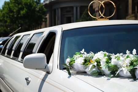 White wedding car decorated with flowers