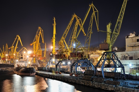 night view of the industrial port with cargoes and ship Stock Photo