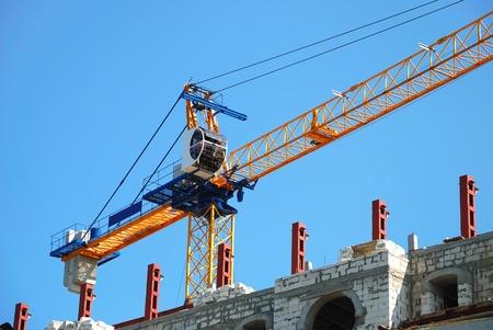 The building crane near not complete skyscraper photo