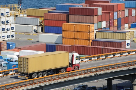 container port: truck transports container to a warehouse near the sea