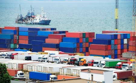 Port warehouse with containers and industrial cargoes Stock Photo
