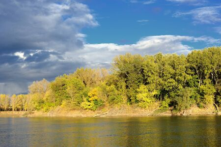bright landscape. forest, river and sky photo