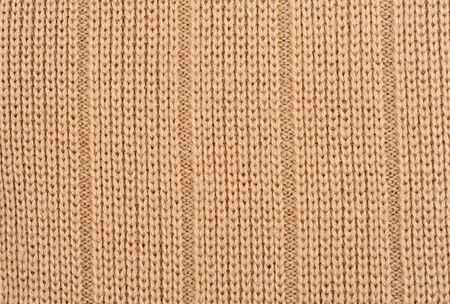 light brown knitted wool as background photo