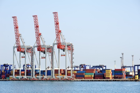 commerce and industry: port cranes and container warehouse