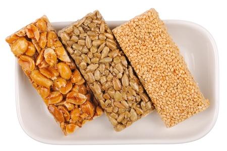 gozinaki: Honey bars with peanuts, sesame and sunflower seeds isolated