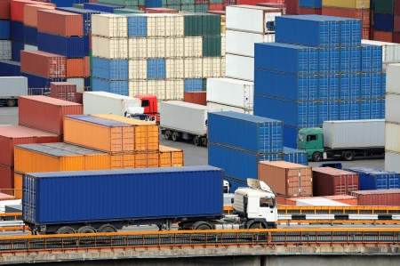 truck carries container to a warehouse near the sea photo