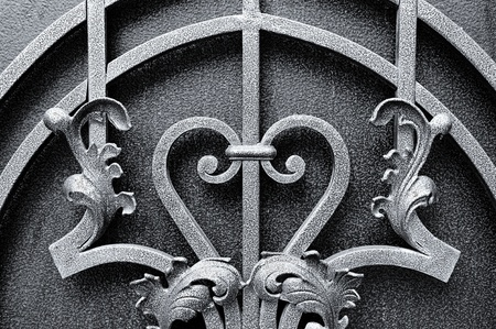forge: Iron fence designs. Forged decorative fence. Stock Photo