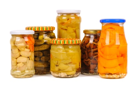 set of canned vegetables. cucumbers, peppers and mushrooms, isolated photo
