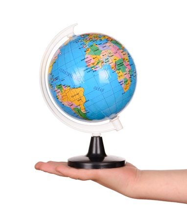 childs hand holding a globe. isolated photo