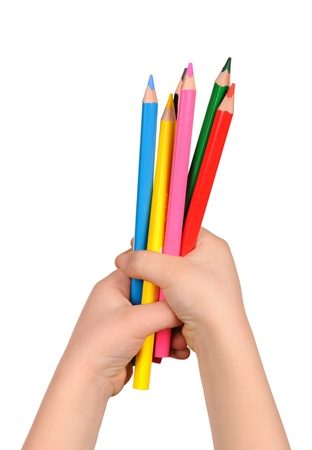 Childrens hand holds the colorful pencils. isolated photo