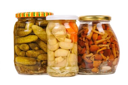 a set of canned vegetables. cucumbers, mushrooms and carrots. isolated photo
