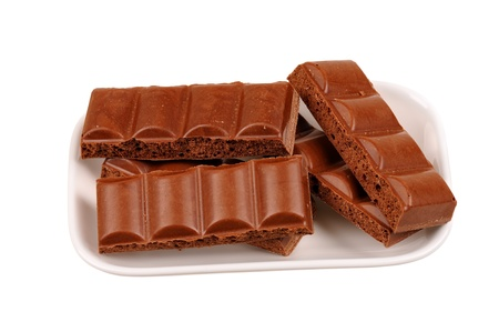 honeycombed: pieces of chocolate bar on a plate. isolated