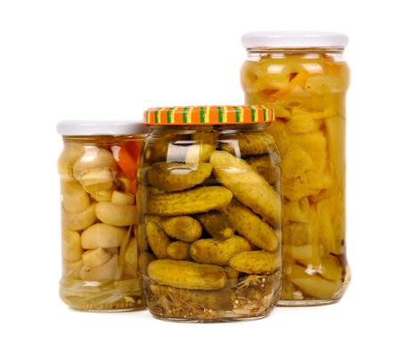 canned goods: set of vegetable preserves. cucumbers, peppers, mushrooms. isolated Stock Photo