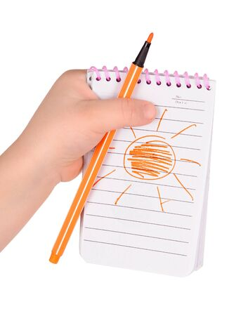 scratchpad: childrens hands hold notebook with a painted sun. isolated Stock Photo