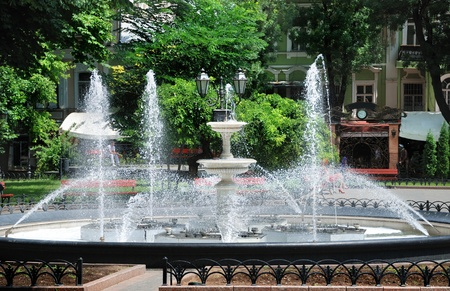 big fountain in city park photo