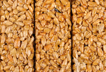 gozinaki: Honey bars with sunflower seeds isolated