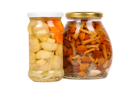 set of canned vegetables. mushrooms and carrots. isolated photo