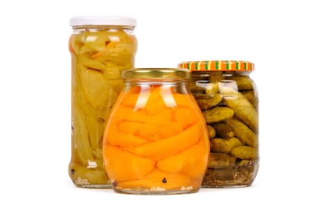 canned vegetables. cucumbers, peppers and mushrooms, isolated photo