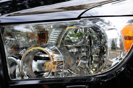 black automobile headlight as background photo