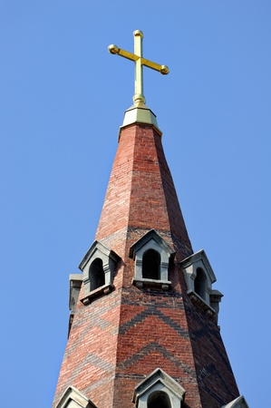 cross on the dome of church photo