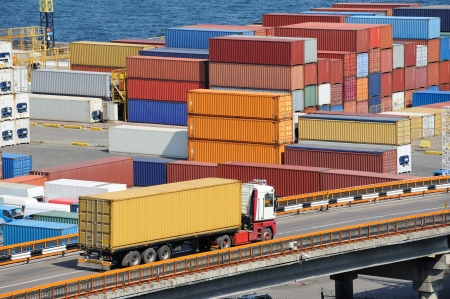 truck transport container to a warehouse near the sea photo