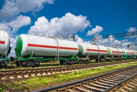 railroad transportation white tank cars with oil photo
