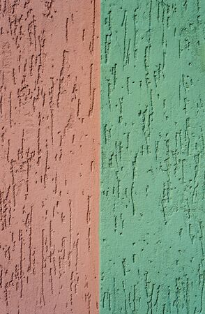 striated: red and green striated stucco wall texture