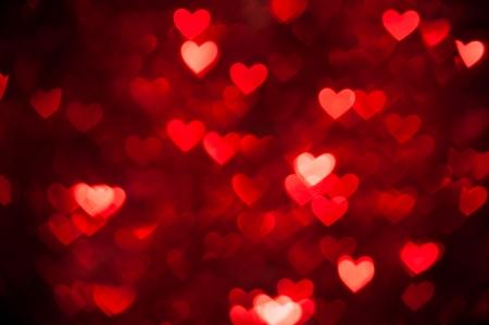 corazones rojos bokeh como fondo