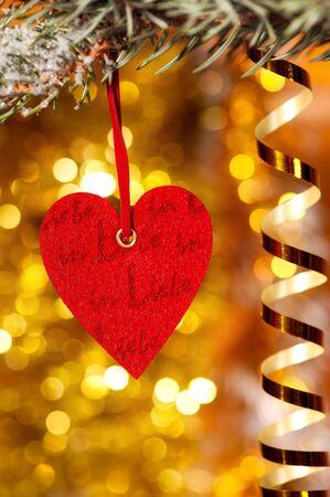 one heart on christmas fir tree branch and golden background Stock Photo - 16784767
