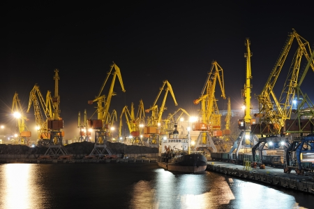 industrial port and ship at night photo