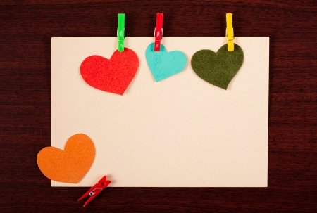 card with hearts on a wooden background photo
