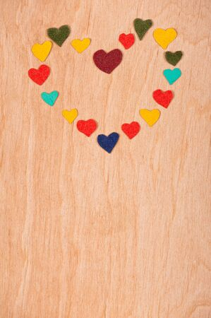 set of hearts on a wooden background photo