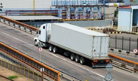 Transportation of cargoes in containers by lorry Stock Photo - 16904189