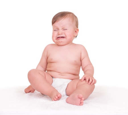baby cries on white photo
