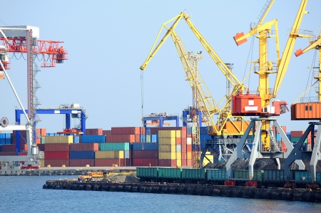 tons: Port warehouse with containers and industrial cargoes Stock Photo