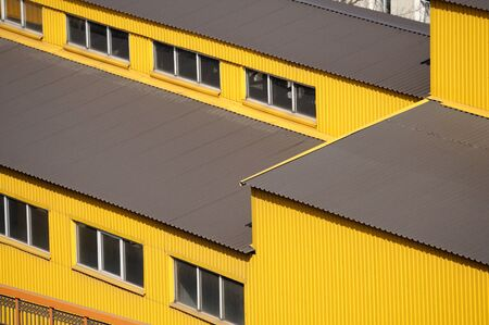Yellow siding wall and roof as background photo