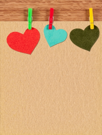 card with hearts on wooden background photo