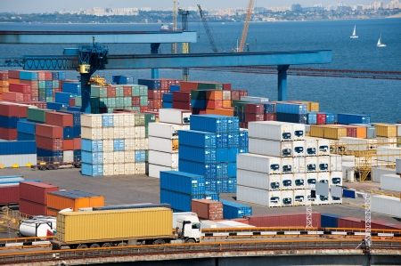 truck transport container to warehouse near the sea photo