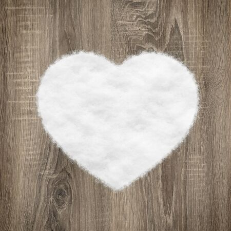 heart shape made of wood and snow photo