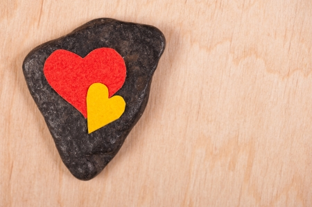hearts on stone and wooden background photo