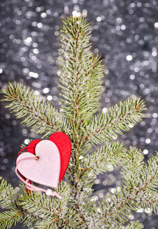 hearts on christmas tree and silver background photo