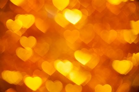 burnish: yellow hearts bokeh background
