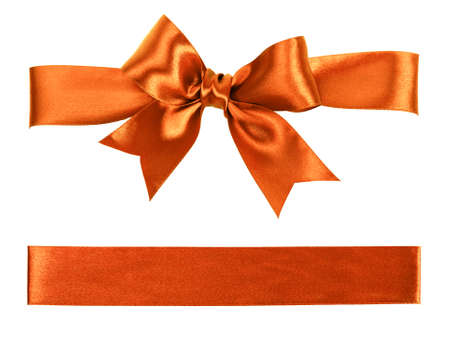 big orange bow made from silk ribbon photo