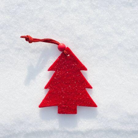 plushy: plushy red fir tree toy on snow background Stock Photo