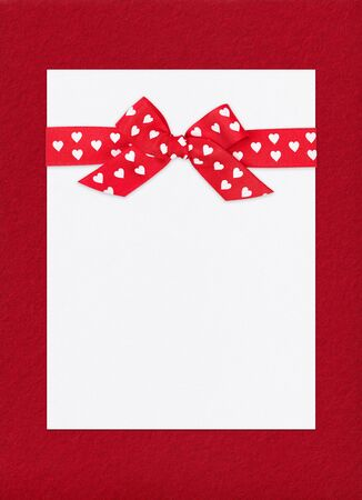 big red bow on paper sheet photo