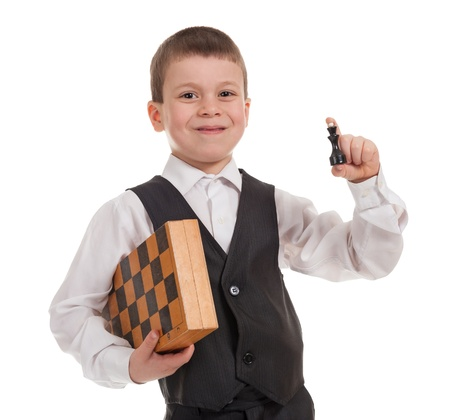 smiling boy with chess isolated photo
